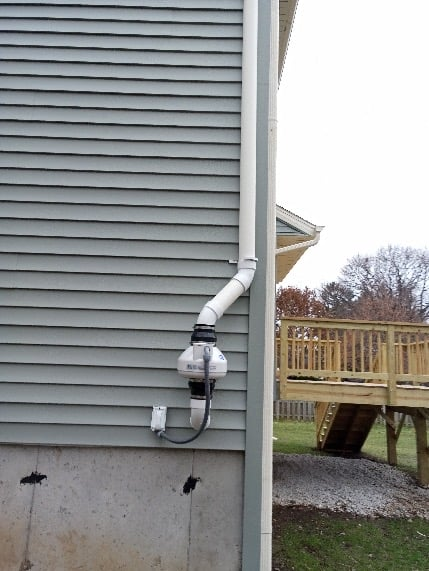 Milwaukee Radon Mitigation Mitigators Radon System on outside of home in Shorewood